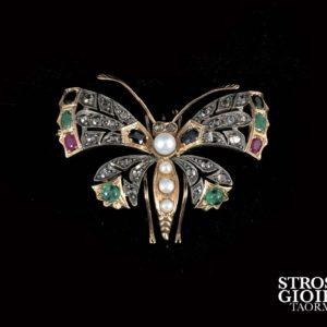 Spilla a forma di Farfalla in oro ,argento, rose di diamanti e pietre preziose